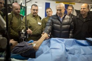 israeli-prime-minister-benjamin-netanyahu-next-to-a-wounded-mercenary-israeli-military-field-hospital-at-the-occupied