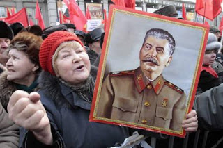 Woman Moscow holding Stalin's cadre